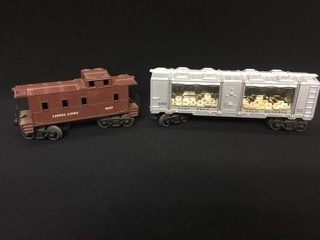 VINTAGE LIONEL TRAIN POST WAR LOT INCLUDES NUMBER 6445 FORT KNOX GOLD RESERVE AND A LIONEL 6017 BROWN CABOOSE.