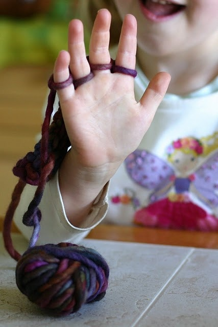 Knitting with your fingers. Great activity for older children. ----or for me