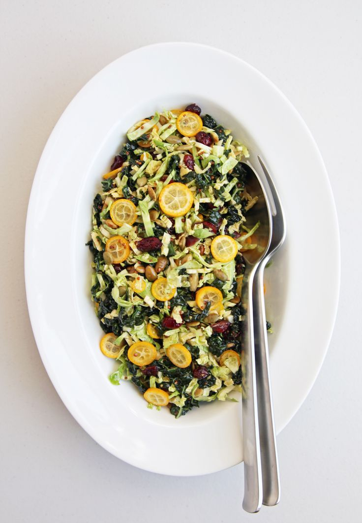 Shredded Brussels Sprouts and Kale Salad with Kumquats and Tamari Pepitas