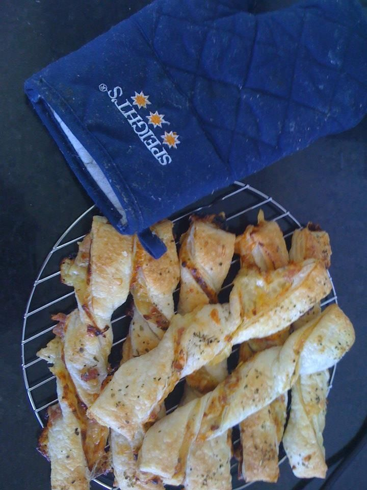 Cheese bacon and sweet chile twists. Just lay out one sheet of puff pastry, spread on your fillings, put on a top layer of puff pastry, slice into strips and twist and bake- delicious. Can add anything you like eg onion