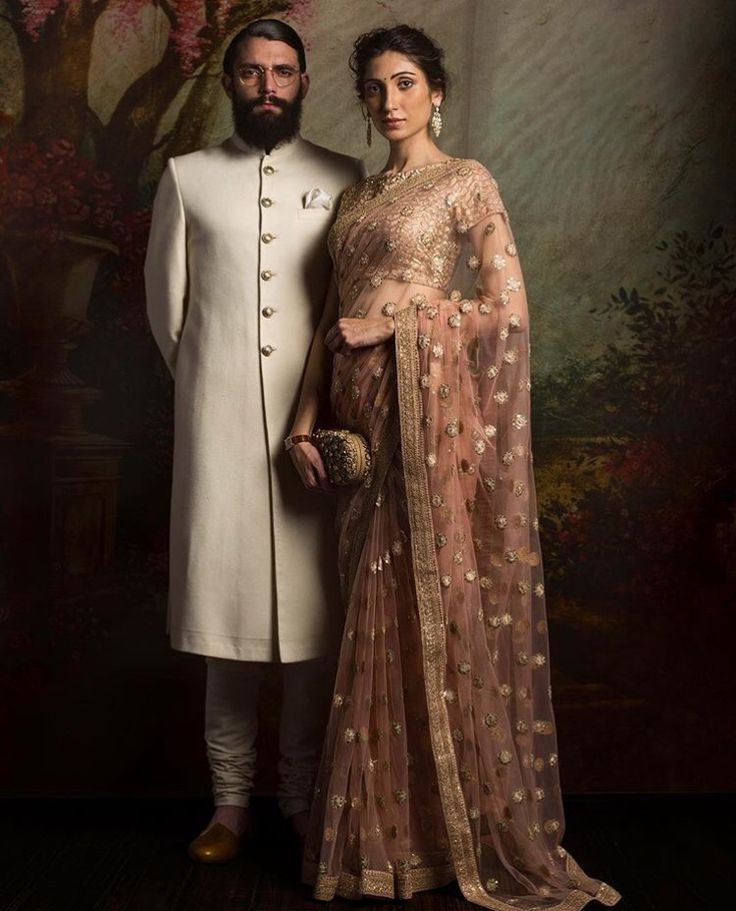 The best way to flaunt this Sabyasachi designed rose-pink saree is to match it with an ethnic pair of dangling earrings and a clutch | wedding goals | wedding inspiration | wedding blogs | wedfine.com |