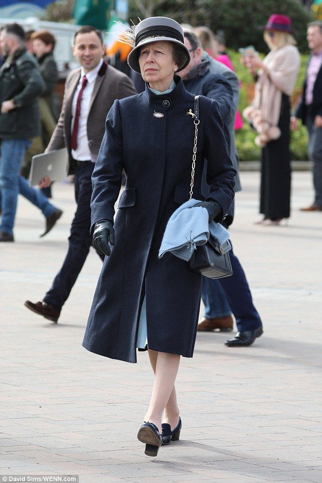Princess Anne also attended the races today, opting for a sophisticated navy coat...