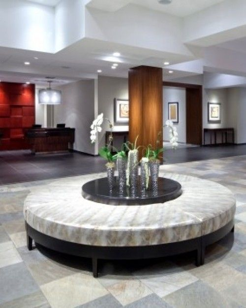 The clean-lined modern lobby mixes natural textures with sunset hues and pops of royal purple.