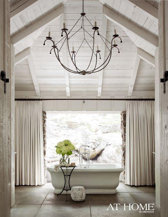 Atlanta homes lifestyles bathrooms waterworks empire freestanding rectangular composite bathtub vaulted ceiling iron chandelier woo