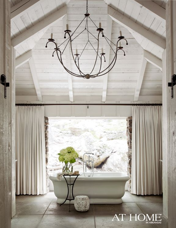 Love the tub, but that chandelier rocks my world!