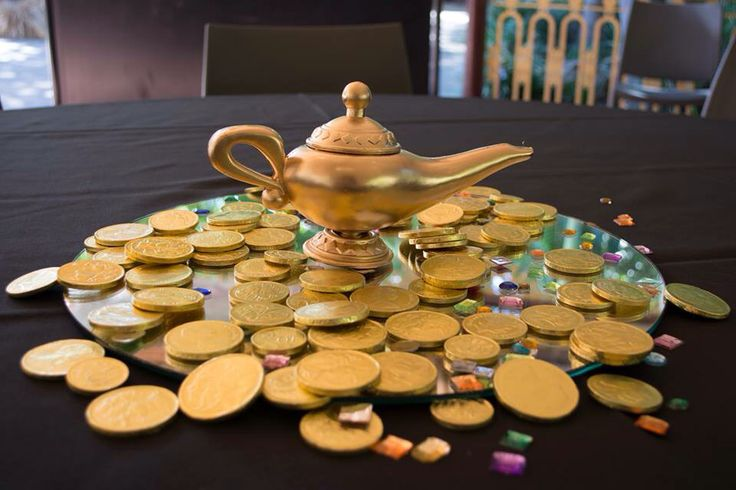 I found online a cheap aladdin lamp, which I did have to paint again. Then I got some chocolate coins and some fake jewels scattered around for the cave of wonders affect