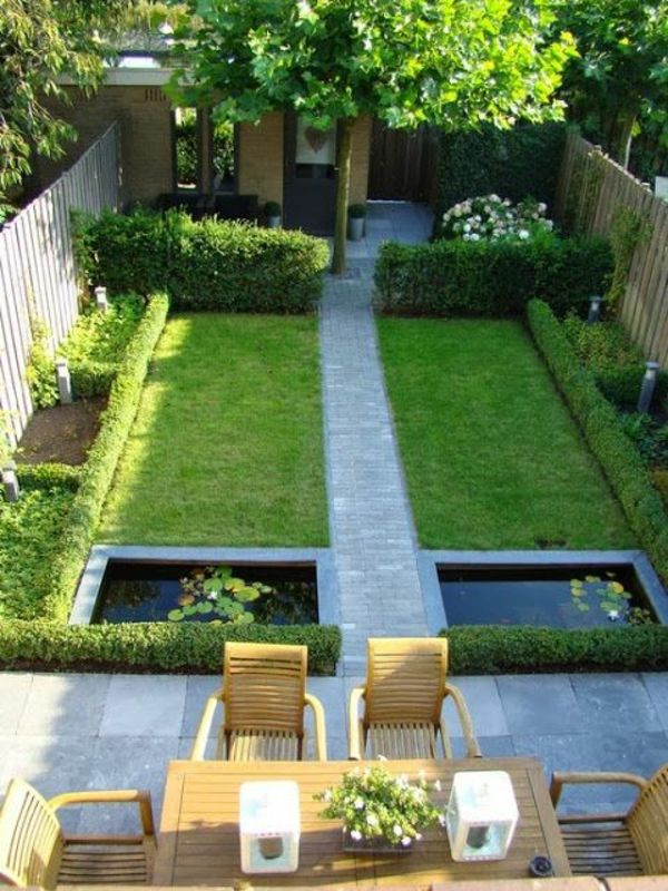 I Love the simplicity and greeness of this garden with the cobble stoned path, the water features and the inviting cosy patio.