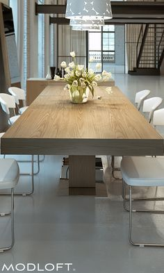 Modloft's best-selling dining table, the Astor is a stunning anchor to a modern dining room. Extendable to seat 10, this table means business. Available in our quick-ship program for immediate delivery.