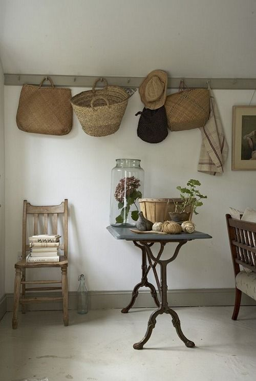 Baskets hanging from a shaker peg rail for an uncomplicated country look