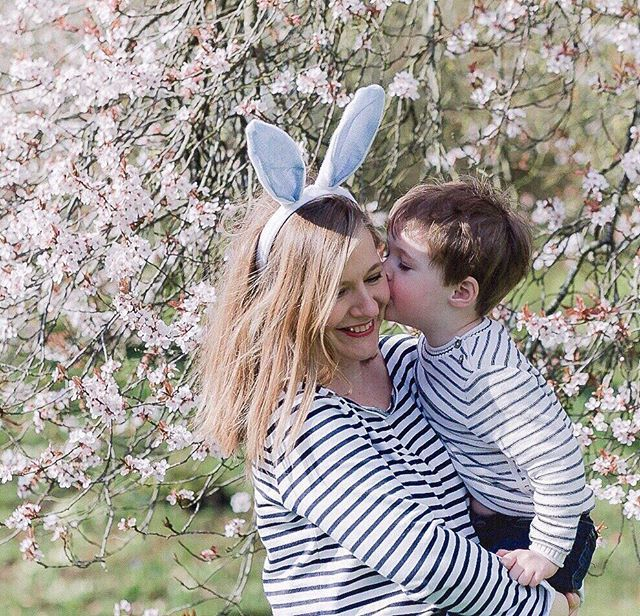 Easter morning under the blossoms. . I took a photo under this tree with Edward just over a year ago and wanted to return to the same place. After various photos of me trying and failing to persuade him to wear the bunny ears this was the final picture - hes planting a big sloppy kiss on my cheek possibly out of relief that the photo shoot was finally over. . #littlefamiliesofig #adventurelikebeatrixpotter #awanderfulchildhood #kindermemories #the_sweet_life_unscripted #pinklinker…