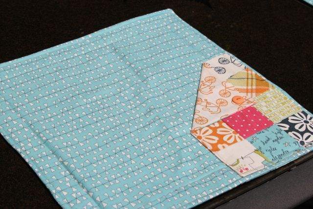 Patchwork Pocket Placemats — from Peas In A Pod. They were made following Lucy's Lunchmat pattern. #placemats #picnic #brightideas