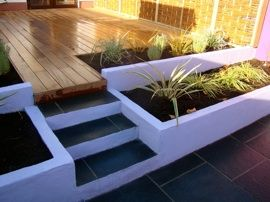 Swords garden. split level garden. gardener. gardens. planting. deck boards. stone steps.