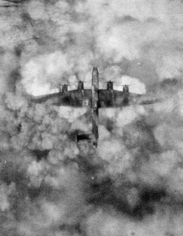 Handley Page Halifax B Mark III, LW127 'HL-F', of No. 429 Squadron RCAF, in flight over Mondeville, France, after losing its entire starboard tailplane to bombs dropped by another Halifax above it. LW127 was one of 942 aircraft of Bomber Command despatched to bomb German-held positions, in support of the Second Army attack in the Normandy battle area (Operation GOODWOOD), on the morning of 18 July 1944. The crew managed to abandon the aircraft before it crashed in the target area.