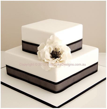 Love the texture/different shades on the ribbon. Would love navy blue ribbon like this wrapped around the bottom of each tier