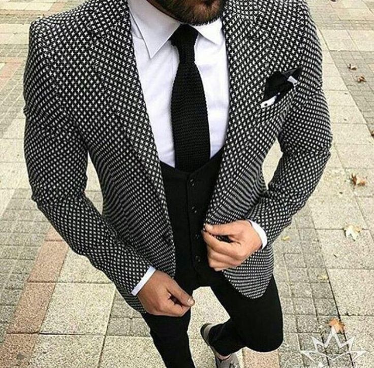men's black and white print blazer with black tie, black vest, and black pants