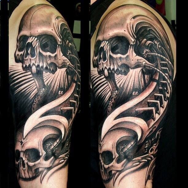 Interesting skulls tattoo