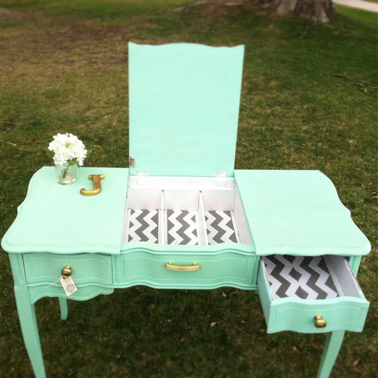 mint green and chevron desk/vanity i think if you put a glass over the slots at the top you could hold make up products or supplies