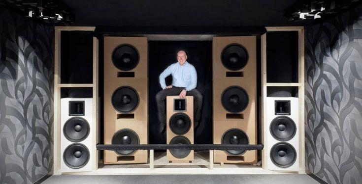 Speaker array behind screen