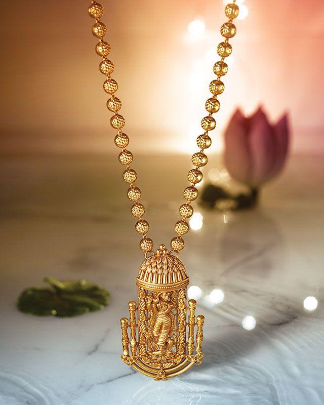 Krishna pendant and chain by Tanishq. Gold jewellery.
