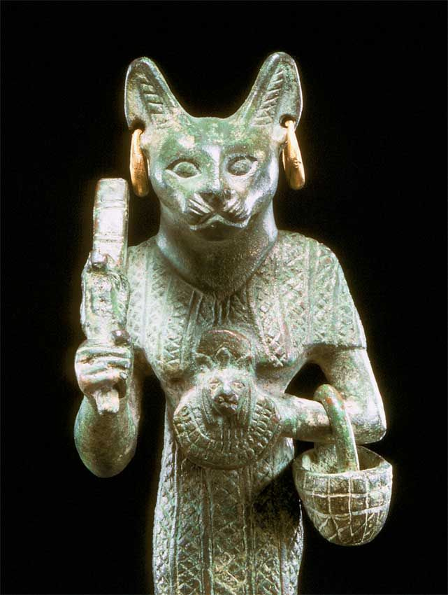 Egyptian bronze sculpture of bastet with gold earrings
