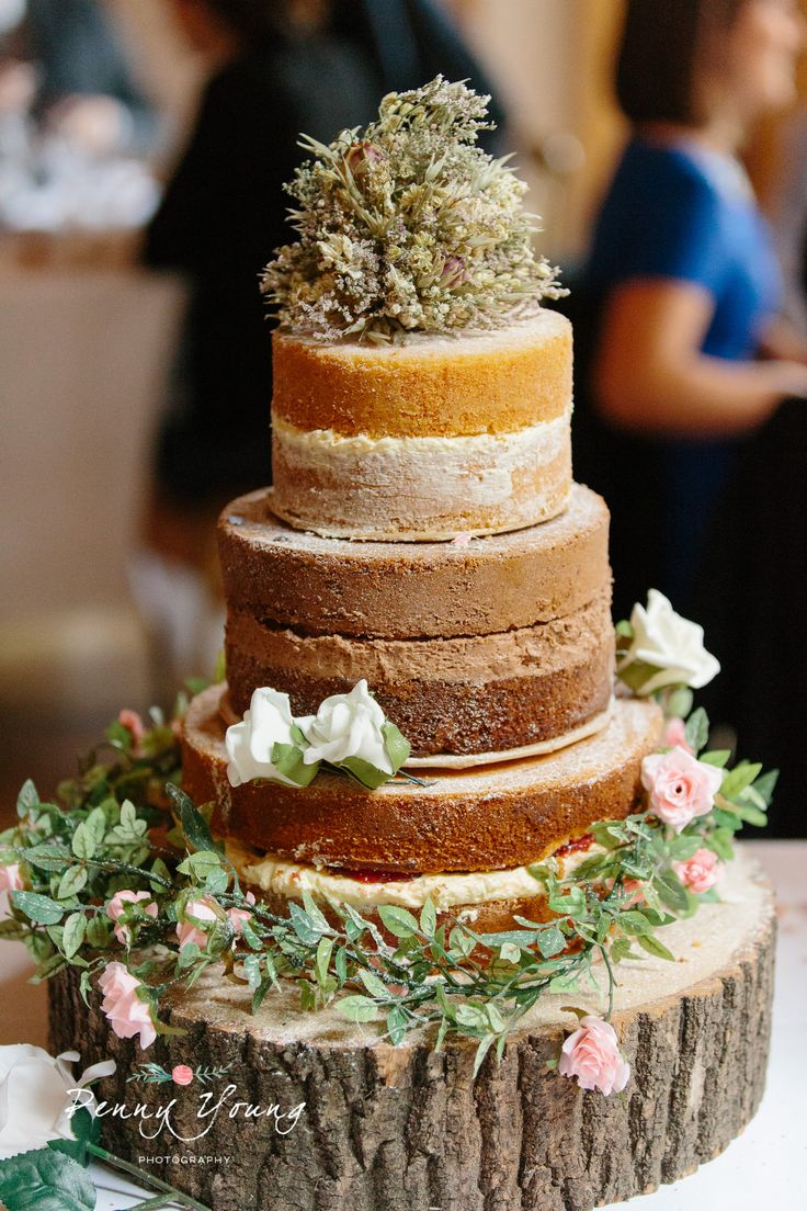 Rustic themed naked cake. Summer wedding at Vaulty Manor in Maldon Essex. Barn wedding. Rustic themed wedding. Photography by Penny Young Photography.