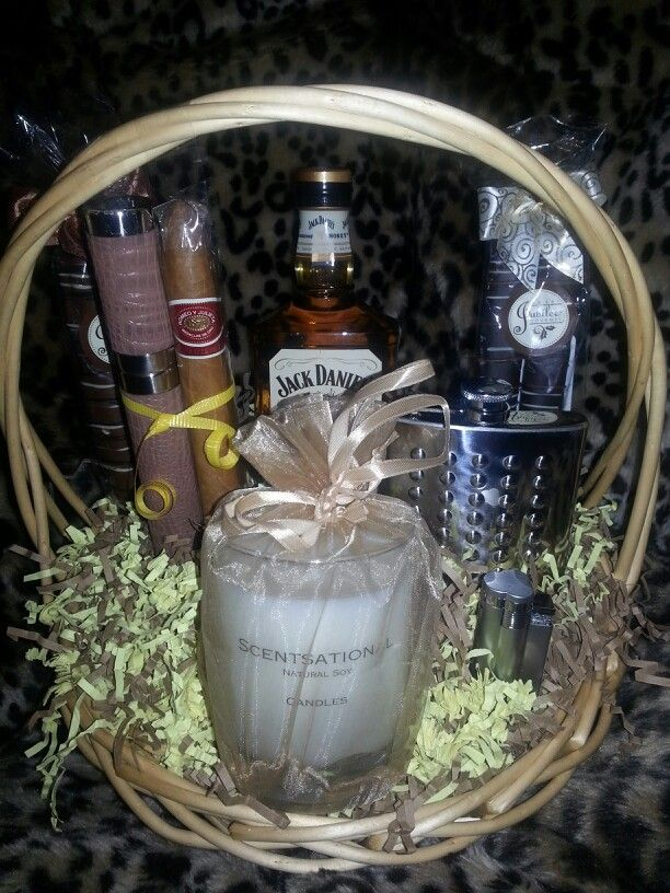 CIGAR LOVERS BASKET~Exclusive raffle gift for Gold card memebers at the Cigars & Stilettos Event~A pint of Jack Daniels Tennessee Honey Whiskey, a flask, a butane lighter, 2 packs of chocolate covered pretzel rods (1 dark chocolate , 1 light chocolate), a white tea scented soy candle, a cigar tube and a Romeo and Julieta Medallas De Oro cigar.~$156.00 value