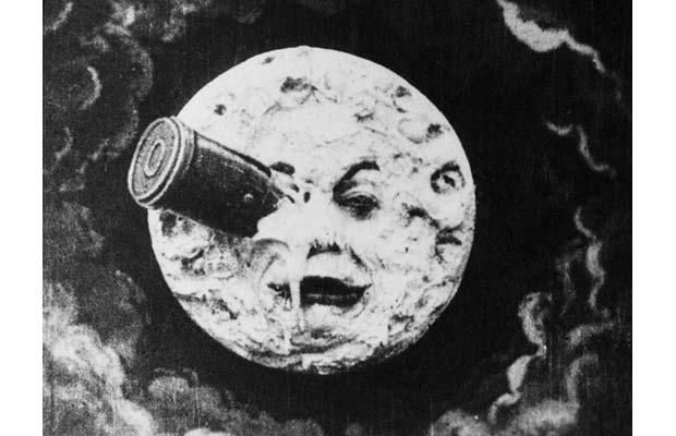 A shape like a bullet landed on the moon on the eye that has a face.