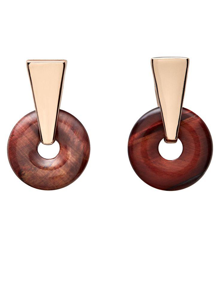 Brincos formados por uma pedra circular. Apresenta fecho de pressão.