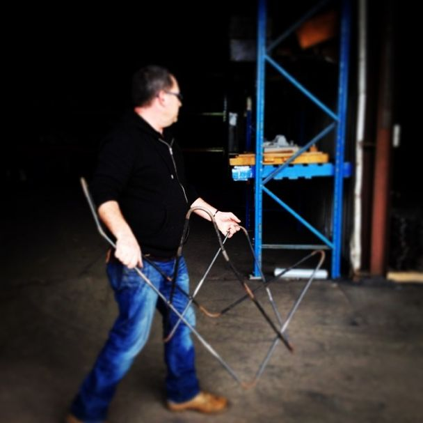 Nathan from Billman's Foundry carrying our frame to the sandblasting room. {www.TheButterflyChair.com.au — Made in Castlemaine}