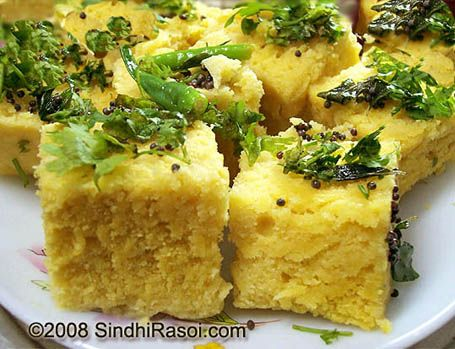 Dhokla is a snack from the indian state of gujarat dhoklas are dhokla is a snack from the indian state of gujarat dhoklas are steamed cakes made with a fermented batter of chickpeas usually served with hot gr forumfinder Images