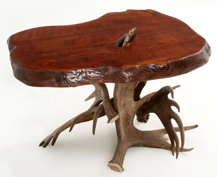 Naturally shed moose antlers are combined with natural solid slabs of redwood for a beautiful rustic table for cabin, lodge, ranch, western, & rustic decors.