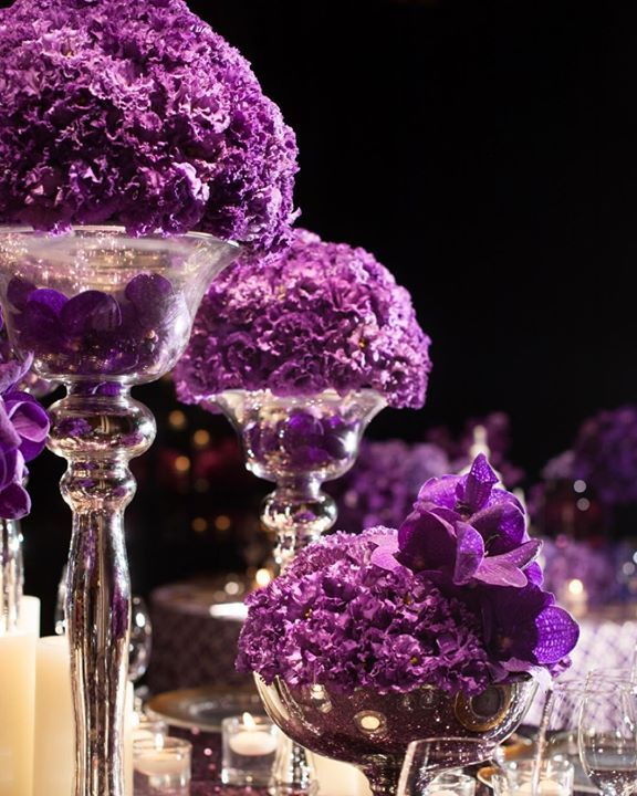 Purple carnations in mercury glass vessels are a great reminder that one type of flower done in abundance can be stunning - Jeff Leatham