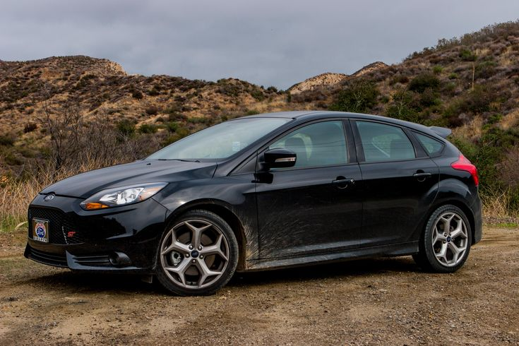 2013 Ford Focus ST... With black rims of course, and where is the tinted windows. This is my next car!!