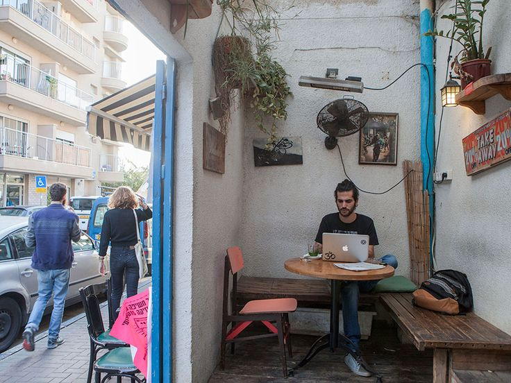 In this photo taken on Tuesday, Nov. 10, 2015, an Israeli man appears in a cafe in the Florentin neighbourhood of Tel Aviv, Israel.