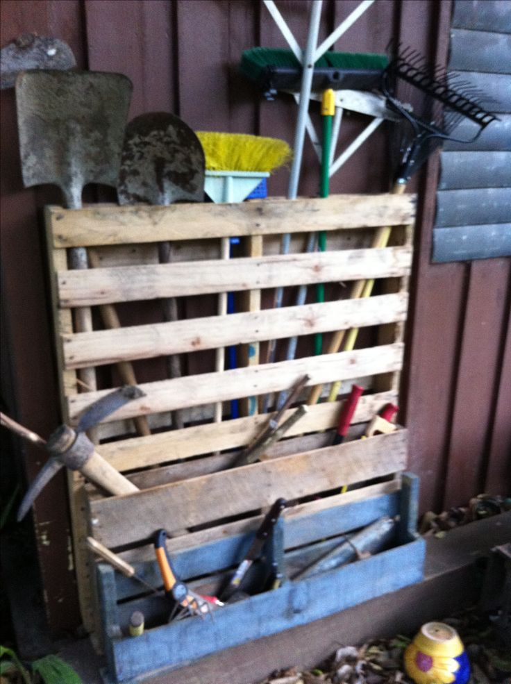 Pallet patio tool rack.   First pallet project. Many more to come. #pallet #pallettoolrack