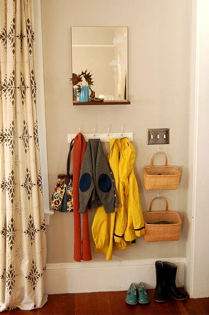 Hang baskets on hooks for extra storage in small spaces.