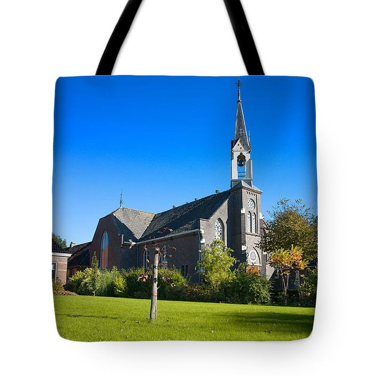 Landscape Tote Bag featuring the photograph Country Church. by Jan Brons. Country church.     A typical Dutch country church. Shot on a beautiful day, with deep blue sky, at a low view looking over the vast green grass of the church garden and lawn.