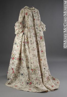 1763 Wedding dress. It is one of the few 18th-century silk gowns with a hand-painted floral design to be found in a North American museum. The soft cream silk was handwoven in China, where the floral pattern was handpainted in tones of lavender, blue, yellow, green and brown.