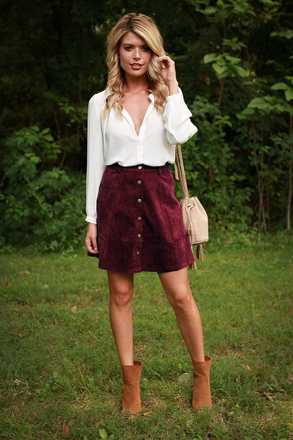 maroon skirt, white top, brown booties