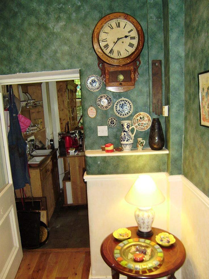 Outside the kitchen. Korund pottery on wall and shelf.