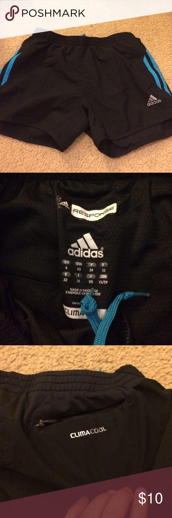 Adidas black blue running shorts Adidas response black with blue stripe running shorts. Climacool. Size XS. Back pocket. Great condition Adidas Shorts
