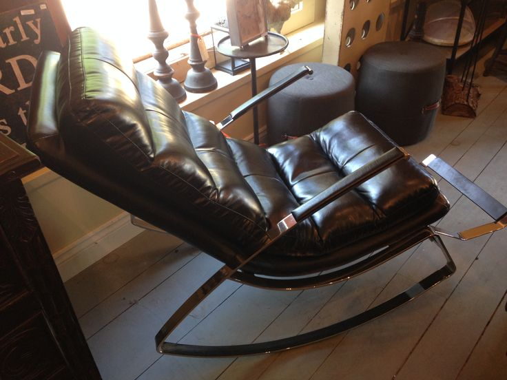 Super cool rocking chair in bonded leather with chrome legs. $975.00