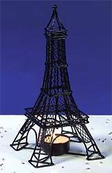 Use this intricate metal Eiffel Tower tea light candle holder as a table centerpiece.