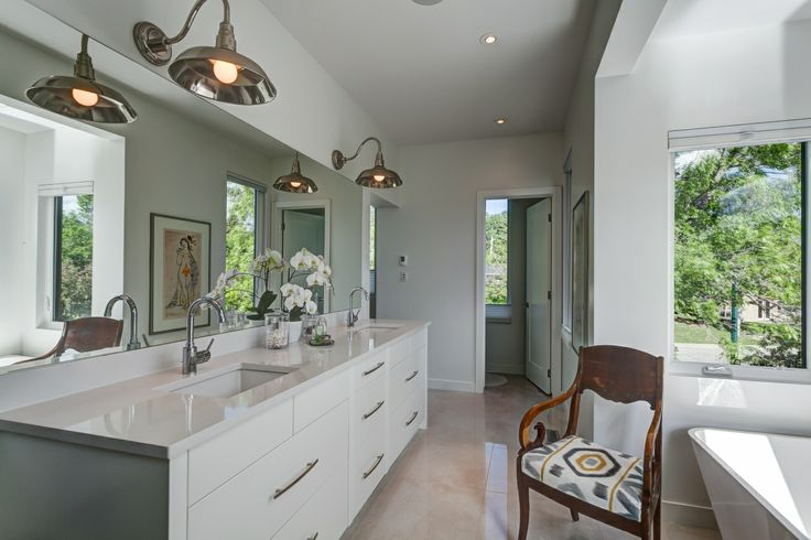 Bright bathroom with large windows, large tiled floors and modern cabinets and fixtures | Calgary