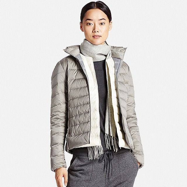 This ultra-light down jacket is thin, light, and warm. Durable water-repellant coating and waterproof threads mean a little rain is no problem. Gradient stitching in the body and curved shoulder stitching give it an attractive, feminine style. Featuring a fitted collar, plus stretch tape cuffs to keep warmth in and drafts out. Great for layering under an overcoat as an inner down layer in extreme cold. Packs down compactly into an included pouch for easy transport, so it's there when you…