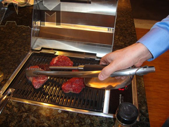 Electric grills are both safer and tastier, with less toxic chemicals.  http://www.electricfireplacesdirect.com/EFD/electric-grill-source.html