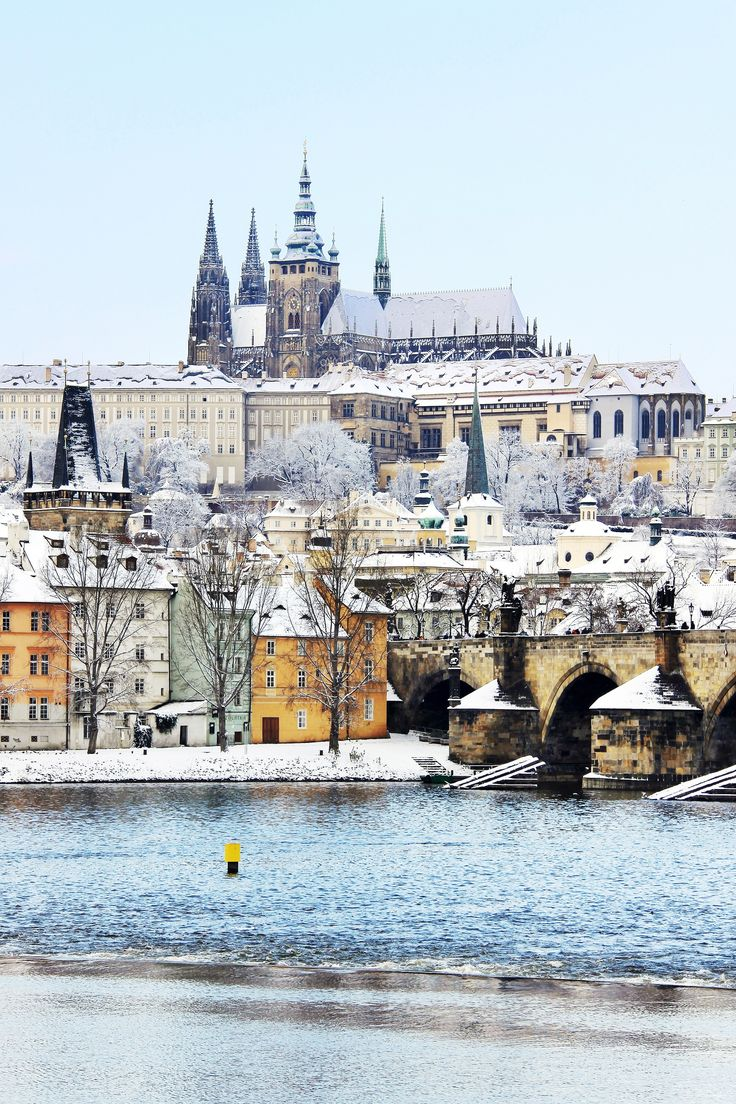 Snowy Prague gothic Castle with the Charles Bridge, Czech Republic