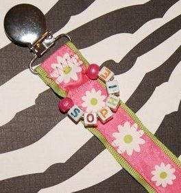 Personalize your Pacifier clip or Sophie/Toy Leash with your little one's name and/or birth date.  8 character max.Leave a comment when placing your order.