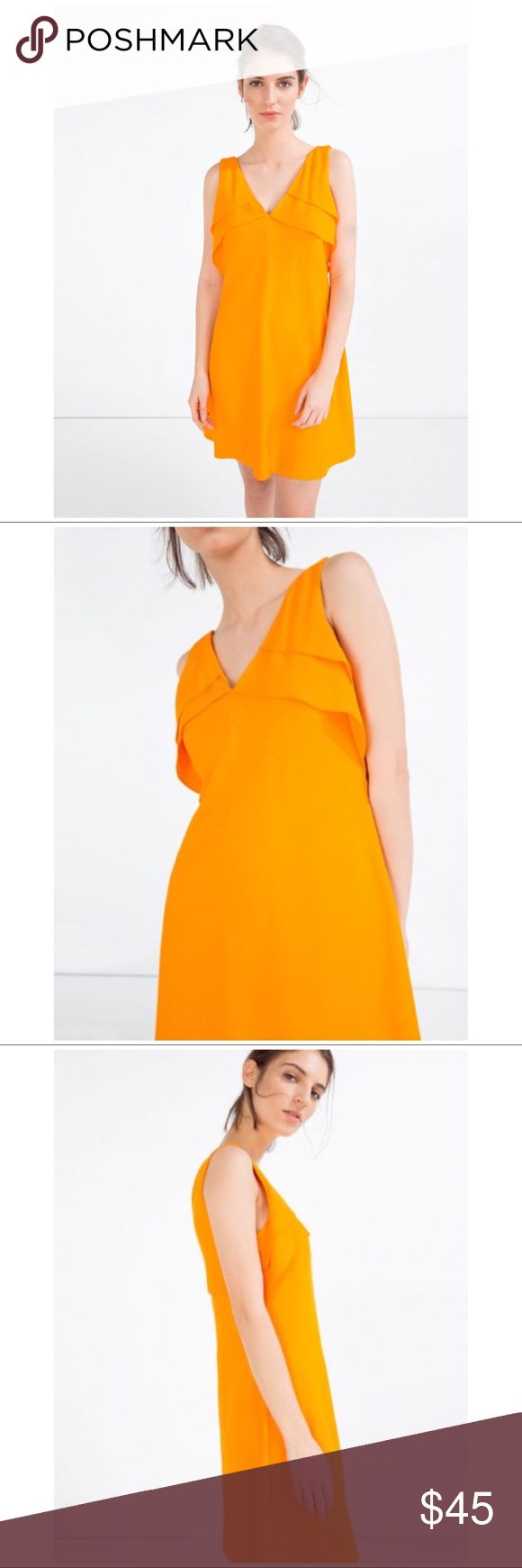 NWT ZARA SHORT FRILLED DRESS SZ XS This is a brand new dress from Zara. No longer sold in stores!  Details include: sleeveless, a v-neck cut on both sides, short ruffles on the front/back, a back zipper, and a mini loose fit.   Original Price: $50 Offers welcome!  #zara #zaradress #dress #zaraorangedress #orangedress #zarafrilleddress #frilleddress #orange #mini #loosefit #frills #frill Zara Dresses Mini