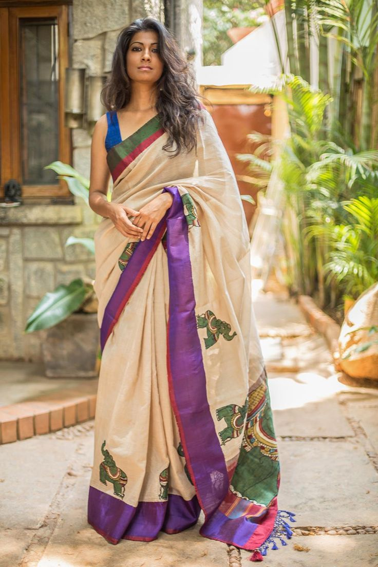 Our popular Kalamkari appliqued Gadwal drape is back! This time in an even more beautiful shade of light beige. Green elephant Kalamkari appliqué work ending in a lavishly worked pallu. A truly lovely saree to add a bit of Kalamkari flavour to your wardrobe.Pick any of the border colors of purple, red or green for a blouse pairing. Or do your thing in a different hued blouse altogether! #kalamkari #saree #India #blouse #houseofblouse